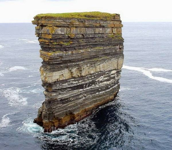 Dun Briste, Ireland. Sedimentary rock, laid down over millions of years at the bottom of the sea, like a slice of layer cake.