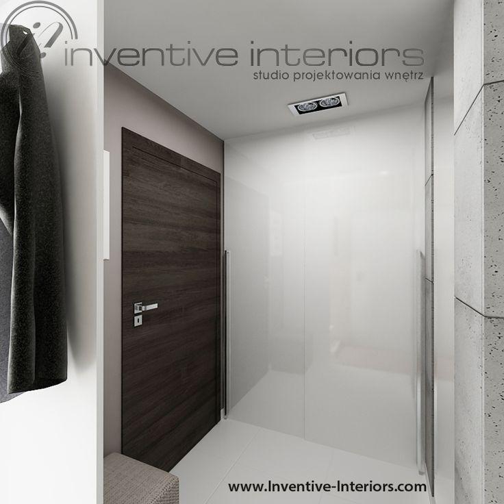 Projekt przedpokoju Inventive Interiors - biała szafa wnękowa i beton