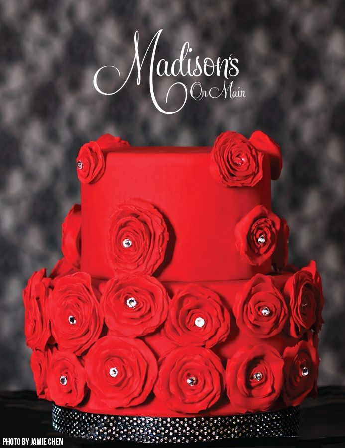 """Red rosettes with swarovski crystals.... - I was asked to make a cake for a bridal magazine, and they gave me the opportunity to use anything """"bridal"""" related as inspiration.  I used the 2013 Vera Wang Red Bridal collection as my inspiration, and hand made paper thin fondant rosettes that I added Swarovski crystals to.  Photo by Jamie Chen"""