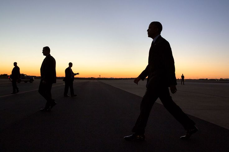 "Nov. 4, 2016 ""Can't pass up a good silhouette. President Obama, surrounded by Secret Service agents, walks across the tarmac to greet the crowd upon arrival at North Carolina Air National Guard Base in Charlotte."" (Official White House Photo by Pete Souza)"