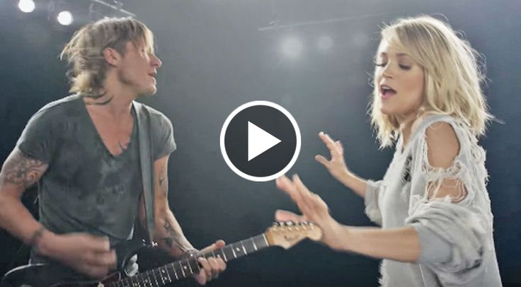 """Just before their performance at the GRAMMY Awards on Sunday (Feb. 12), Keith Urban and Carrie Underwood debuted the """"exclusive first look at [the] music video"""" for their brand new single, """"The Fighter"""".  The video opens with Urban playing the opening riff on his electric guitar interlaced with fo"""