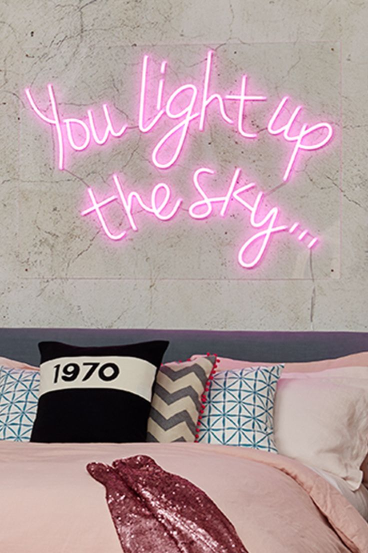 The hot pink neon sign finishes this fun, feelgood Colour