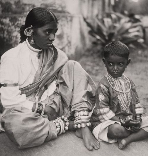 South India - 1Muslim Lady and Child, Ongole, Andhra Pradesh, 1921 (Maynard Owen Williams).A lot of heavy jewellery (silver?) including an armband over a full sleeved blouse. I think the lady is wearing a sari. The child's silk tunic is of a kind common at the time.