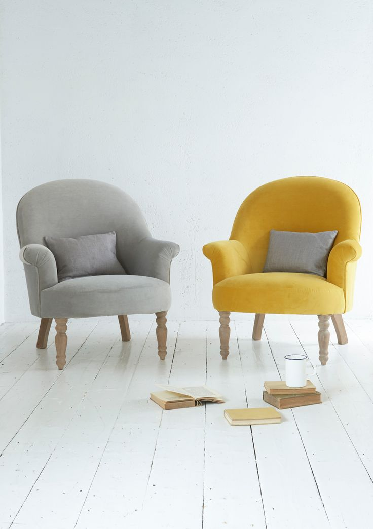 The comfy Munchkin chair is all about down-time. This classic occasional armchair is handmade in Britain and comes with solid weathered oak legs. Upholstered here in Bumblebee yellow and Smoky Grey velvet.