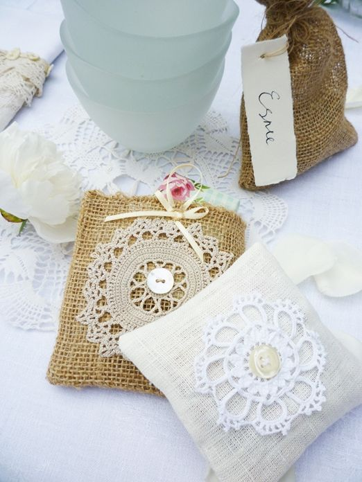 A how to guide to make your own pretty linen and lace pocket wedding favours filled with dried petals from The Brides Table
