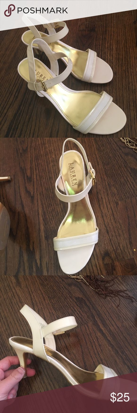 Cream Ralph Lauren Heels gently worn cream Ralph Lauren heels. About 2 inch heels. Classic two strap heels. Very comfortable. A few scuffs on the heel and sole but when wearing look almost new! Gold sole. Toe strap is two-toned and the middle is textured, as seen in picture. Very good quality shoes. Lauren Ralph Lauren Shoes Heels
