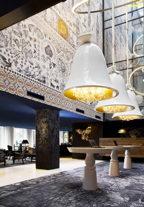 The Andaz Hotel in Amsterdam by Dutch designer Marcel Wanders features chandeliers encased inside huge bells and wallpaper that combines fish with cutlery