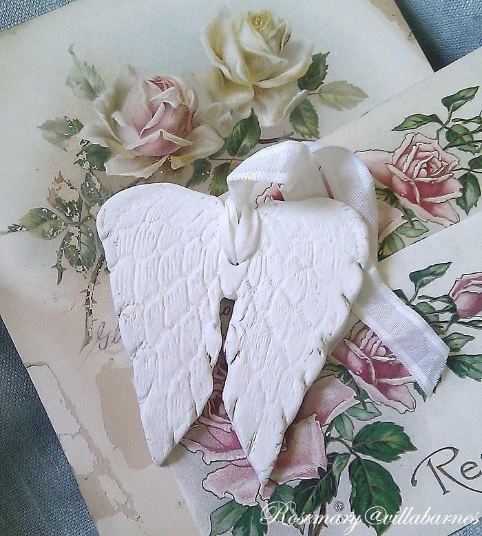 Handmade clay angel wing tag