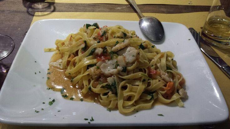 Tagliatelle with scallops and arugula