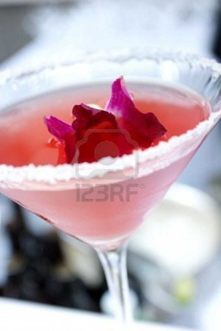 Italian Wedding Cake Cookie Martini      2 fluid ounces vanilla vodka      1 fluid ounce cranberry juice      1 fluid ounce pineapple juice      1/2 fluid ounce amaretto (almond flavored liqueur)      1/2 fluid ounce white creme de cacao