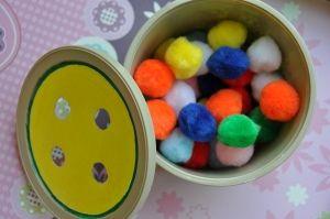 push pom poms through lid - add color matching