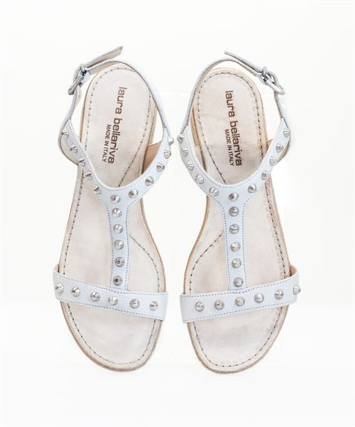 Must-have t-bar flat sandal in crisp white leather embellished with silver studs. Pair with white jeans and striped tee or your Bassike. Made in Italy.