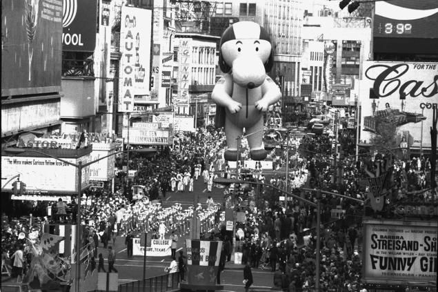 The Kilgore, a Texas band, struts its stuff and so does Snoopy at the 43rd annual Macy's Thanksgiving Day Parade in 1969.