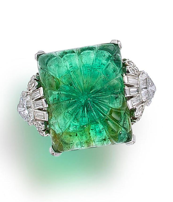 An art deco emerald and diamond ring, circa 1925