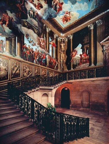 The King's Staircase at Hampton Court Palace, and the most spectacular. It was decorated in about 1700 by Italian painter Antonio Verrio and depicts William III as Alexander the Great victory over the Stuarts