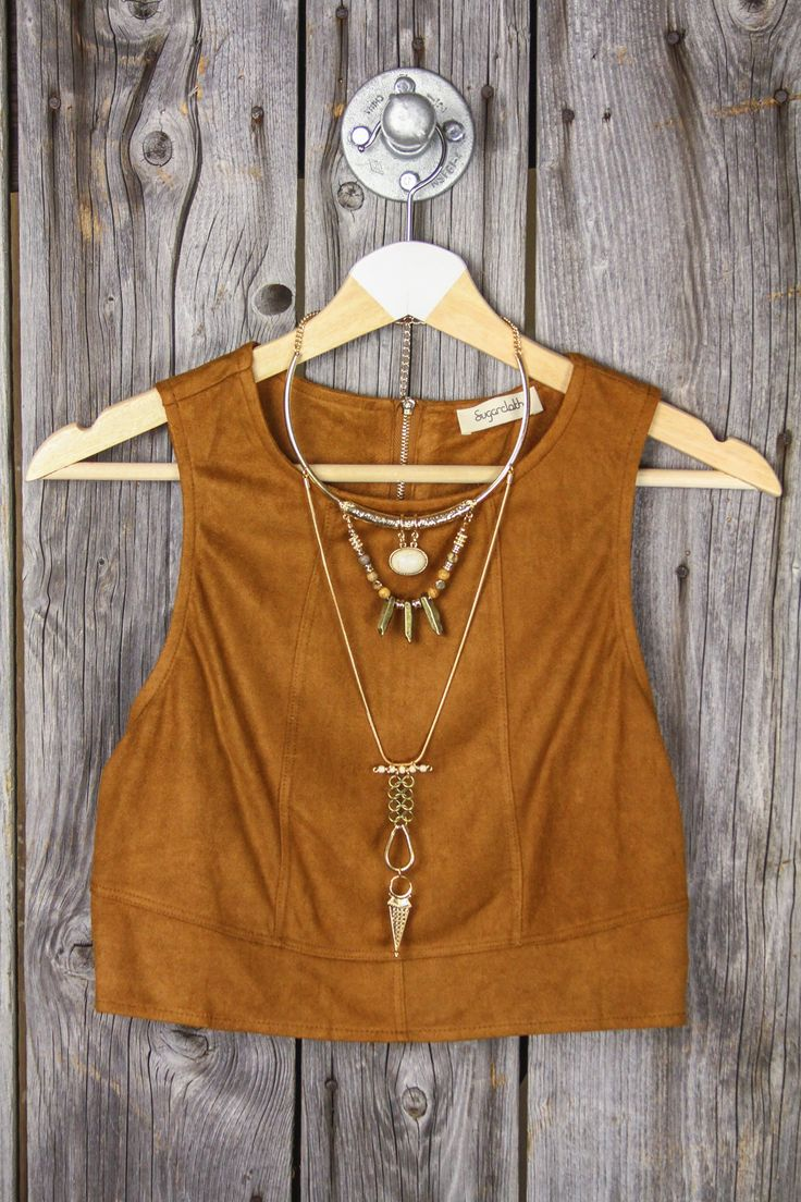 Our super cute + petite crop top comes in an ultra soft sueded material and a rich camel color. · 100% Polyester · EXTREMELY Soft + Lightweight · Slight Stretch + Cropped Cut + Zip Back · Imported