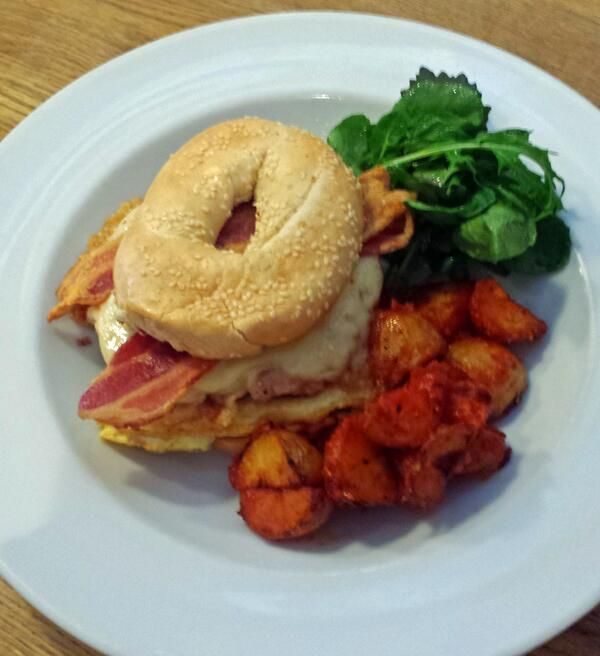Breakfast! @Madebyjonty Sausage meat patty, streaky bacon, emmental cheese and herbed omelette with pattatas bravas