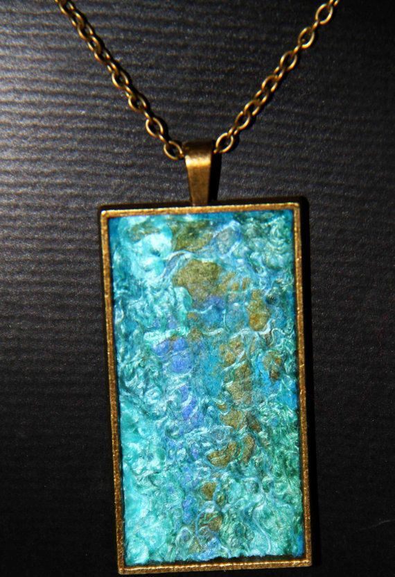 Felt blue pendant with silk.