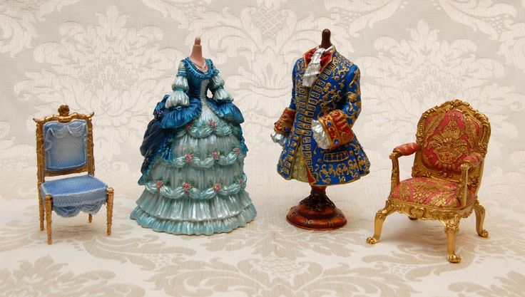 Louie XIV (the Sun King) and Marie Antoinette figurines - along with Marie Antoinette's chair from the Petite Trianon and Louie XIV's royal chair.  Available at www.therubyoracle.com.au