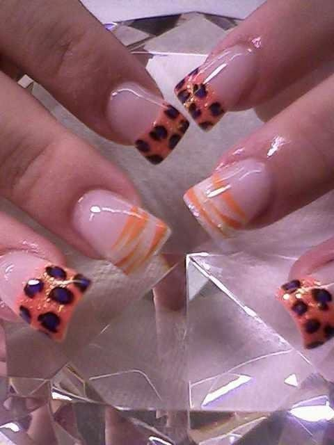 PURPLE AND YELLOW ROCK STAR NAILS