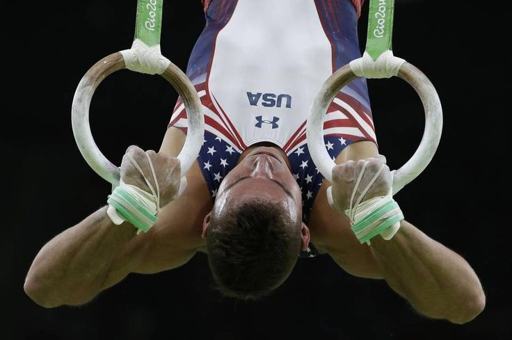 United States' Sam Mikulak performs on the rings during the artistic gymnastics men's qualification at the 2016 Summer Olympics in Rio de…