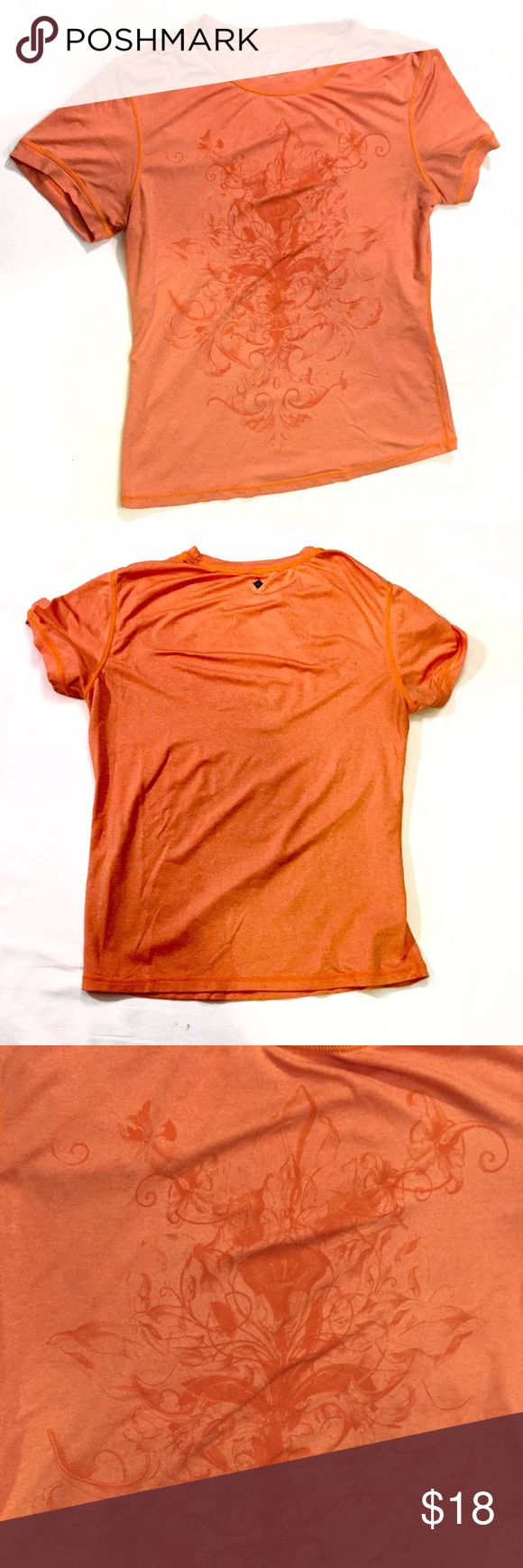 Prana Fitness Top Short Sleeve Orange Size Medium Prana Fitness Top Short Sleeve Orange Size Medium.  Tone on tone lily print.  Gently worn, there is a small mark on the shoulder as seen in photo #4. Prana Tops Tees - Short Sleeve