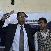 Mr. Kaushlendra Jha admiring a student from RR campus, Janakpur for his impressive thoughts during the Youth Empowerment Program