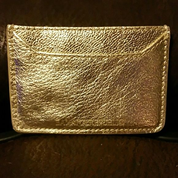 Banana Republic genuine leather credit card wallet Gold genuine leather Banana Republic credit card holder wallet.  One side holds 3 credit cards and other side has one pocket.  Middle also opens for another pocket.  Perfect fit for a clutch on a night out! Banana Republic Bags Wallets