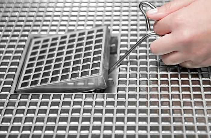 A solution for the shower drain dilemma: Infinity Drains that virtually disappear.