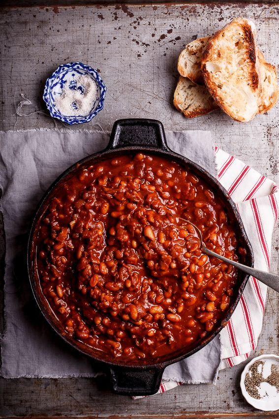 Few things are as delicious as a skillet full of sweet, smoky cowboy beans that have been cooked with bacon, onions and garlic. Perfect comfort food when served on toast. #recipe