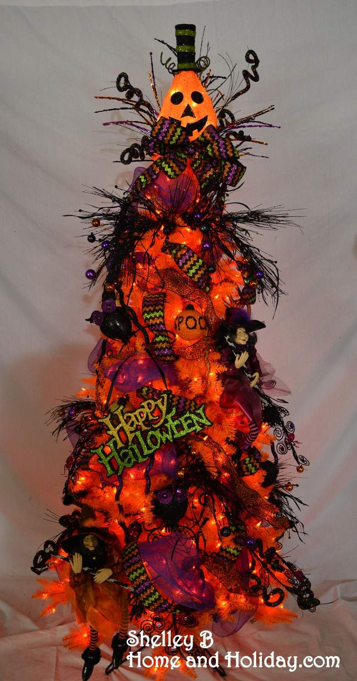 halloween tree orange tree decorated with halloween ornaments and sprays you can find items - Halloween Tree Decorations