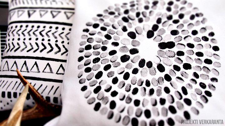 kuviot tehty peukulla painamalla ja vapaasti vesivärisiveltimellä ja kangasvärillä