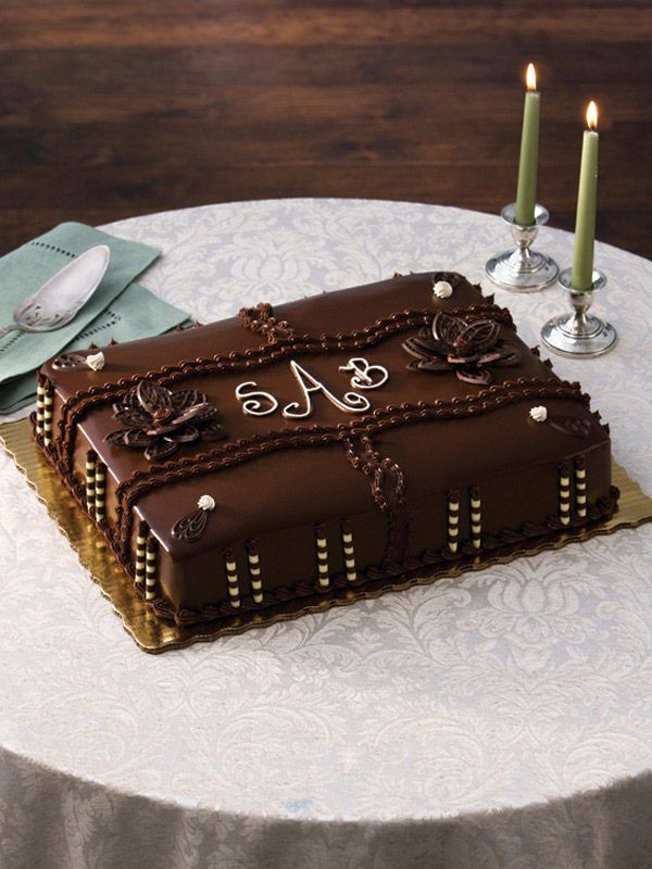 Chocolate Ganache -this would make a cute grooms cake if we just bought some kind of western monograms to go where the chocolate piece bows are...maybe horseshoes for good luck? - Katie