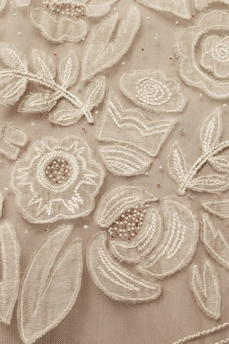 floral applique... could do this with old linens.