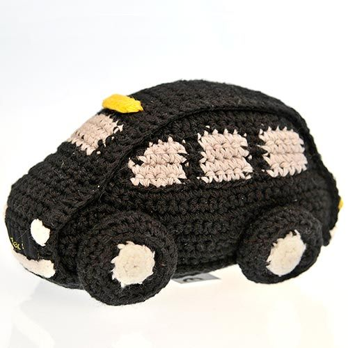 Taxi! Catch this funky London Black Taxi Cab if you can! Expertly crocheted by the ladies of Hathay Bunano in Dhaka, Bangladesh.  Part of the 'Pebble' range of baby toys (but also a great prezzy for lovers of black cabs).  Please note - this toy doesn't actually have a rattle inside.  Machine washable - 100% Cotton outer - Polyester fill - Suitable from birth  Length : 140mm Width : 85mm Height : 90mm