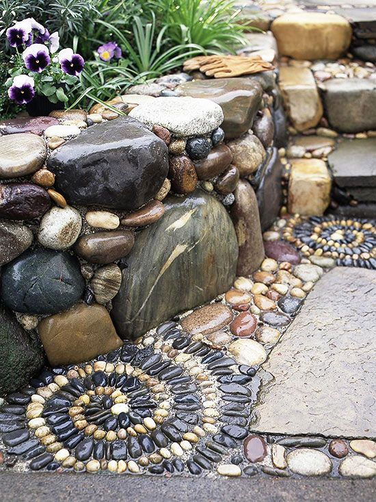Have Some Fun..the stone mosaics the homeowner added at the base of the flagstone walkway. Polished black and white stones were set in concrete in a spectacular spiral pattern.