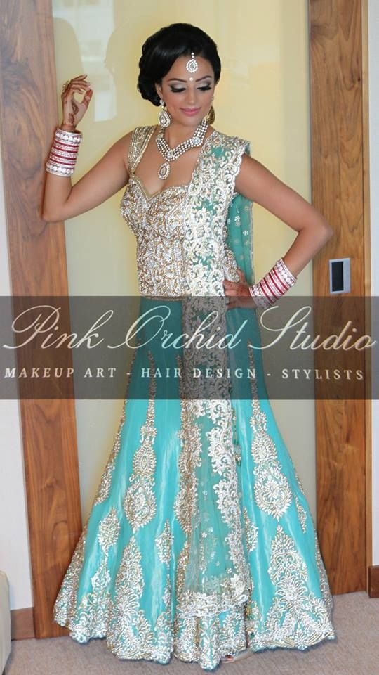 gold and light teal lengha