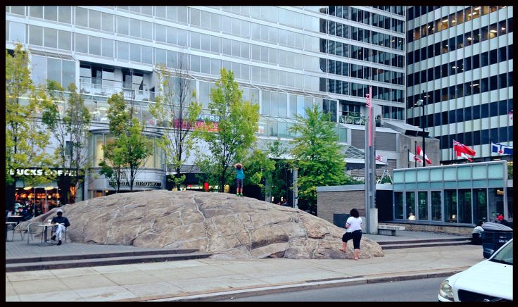 """The """"Rock"""" in Toronto's Yorkville. The """"rock"""" was purchased from a farmer in Northern Ontario, broken up in multiple pieces, then reconstructed in Yorkville."""