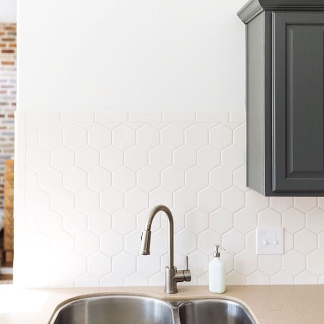 Installing white hexagon tile backsplash in the kitchen. Get all the information and inspiration that you need to tackle this job yourself!