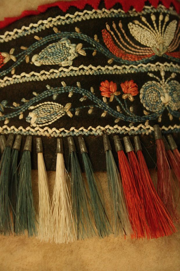 Detail of the shoulder of the hooded capote, complete with tinkle cones with moose hair. The tinkle cones were quite vulnerable to loss.  Courtesy of Maine State Museum.