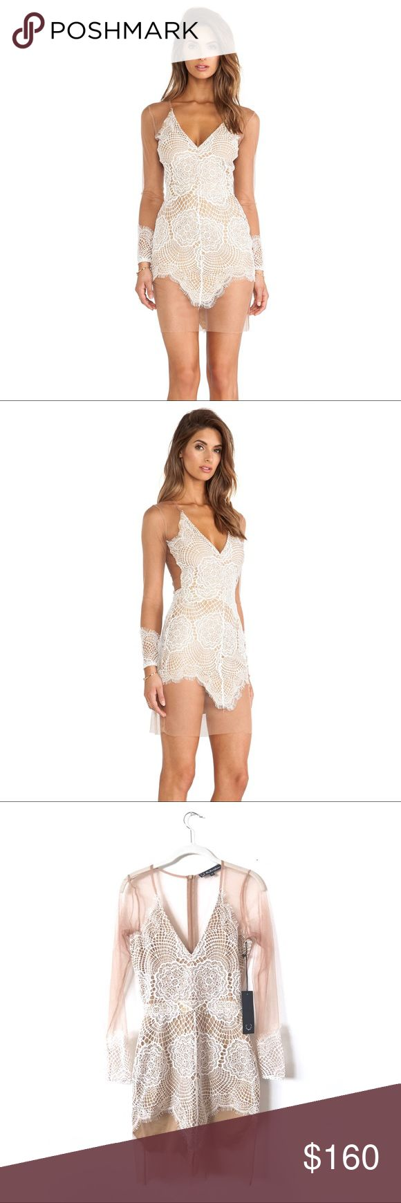 NWT. For Love & Lemons Antigua Mini Dress in White BRAND NEW WITH TAGS!! For Love & Lemons Antigua Mini Dress in White. Delicate modern geometric race backed by nude tulle. Long sleeves with lace cuffs and illusion back. Size M. For Love And Lemons Dresses Mini