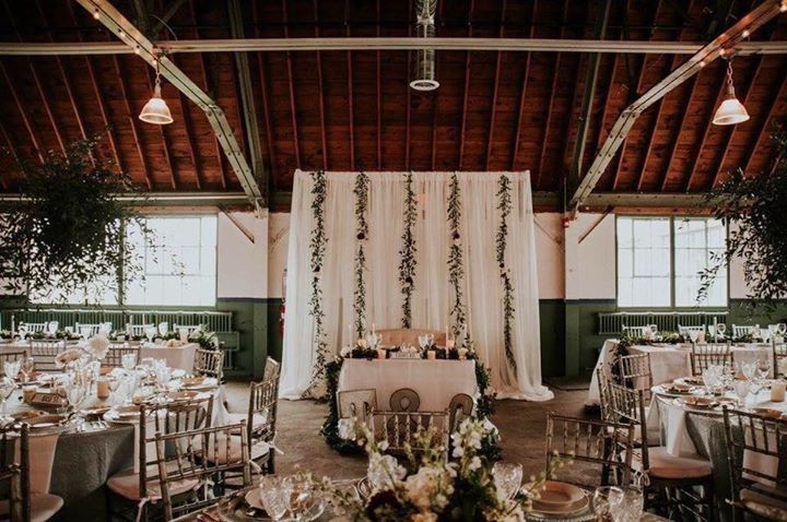 Still one of our favorite set ups with this cozy sweetheart table at the Packard Proving Grounds Historic Site!  Lovely job of set up and decorating by Twigs & Branches Floral and Beautiful Day Planning LLC.