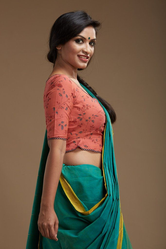 Coralblouse has a peplumwaist band that gives it an old world charm. Hand-block printing detail adds to the quaint look.   THE KAITHARI PROJECT   Handwoven...
