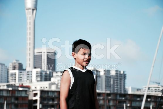 Pacific Island Boy with Auckland Cityscape royalty-free stock photo