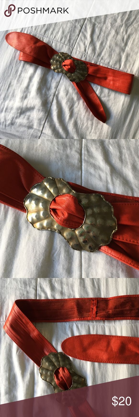 80s Vintage leather belt Red leather belt with hand-made metal buckle. The size is very versatile. 47 inches long. This is from my mom's days as a New Wave party girl in NYC  --- 🙏🏼 --- ➡️ Can't hurt to make an offer!  ➡️ I always ship next day! FYI the package doesn't get scanned until it leaves the shipping center.  ➡️ Please use the offer button! I can't take offers in comment and I won't email you to sell off of PM. Vintage Accessories Belts