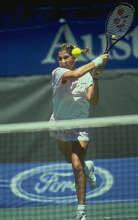 Monica Seles and her lethal double-handed backhand in action at the 1991 Australian Open. Seles defeated Jana Novotná 5-7 6-3 6-1 in the final to win the first of four titles in Melbourne (1991, 92, 93, 96). With this victory, Seles became the first woman in the Open Era to win the Australian Open after saving a match point (against Mary Jo Fernandez in the semi-final). (Photo: Heinz Kluetmeier/SI)