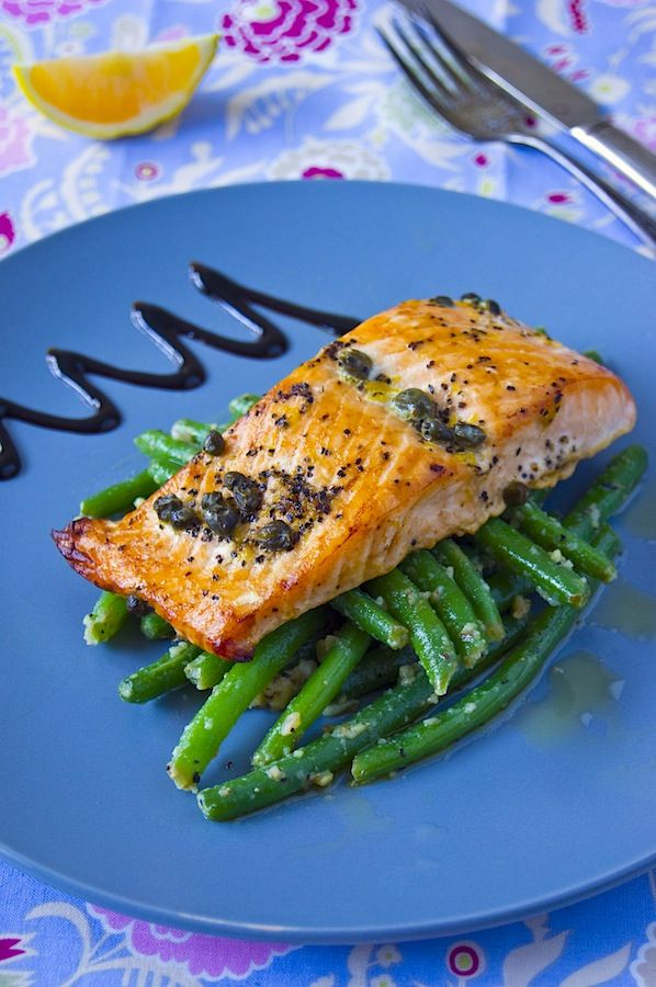 Salmon baked in parchment paper with green beans garnish
