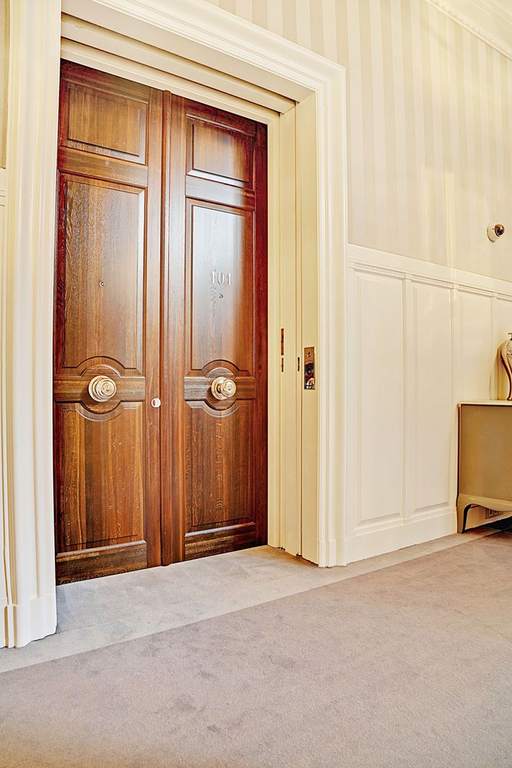 Double door entrance to the Royal Suite in Hotel d'Angleterre. Custom doors measuring 2.76 meter in height are built with Stained oak.
