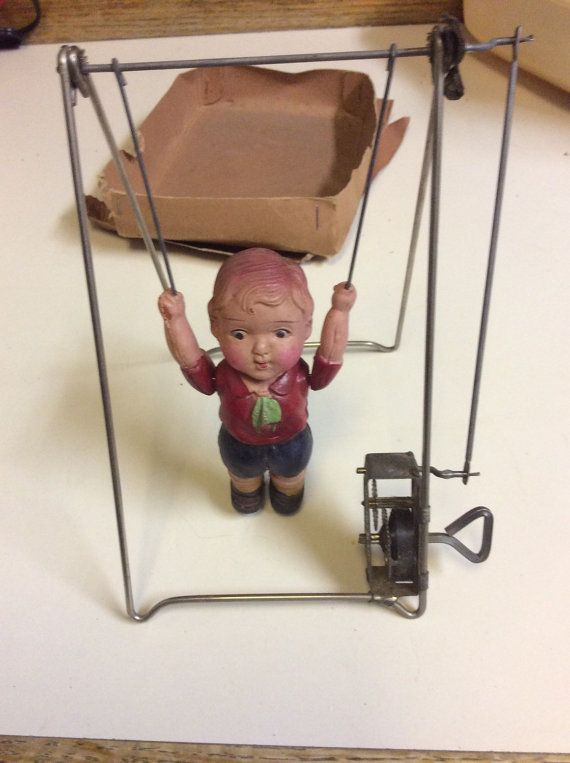 Baby Trapeze Windup Toy