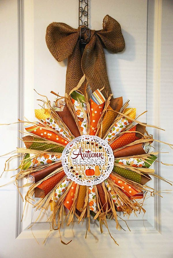 "crafts-n-things-autumn-wreath --use scrapbook/wallpaper paper 5x5"" square, roll up in a cone shape, glue onto 5x5"" cardboard, add raffia, doily on top of cones/paper & decorate!"